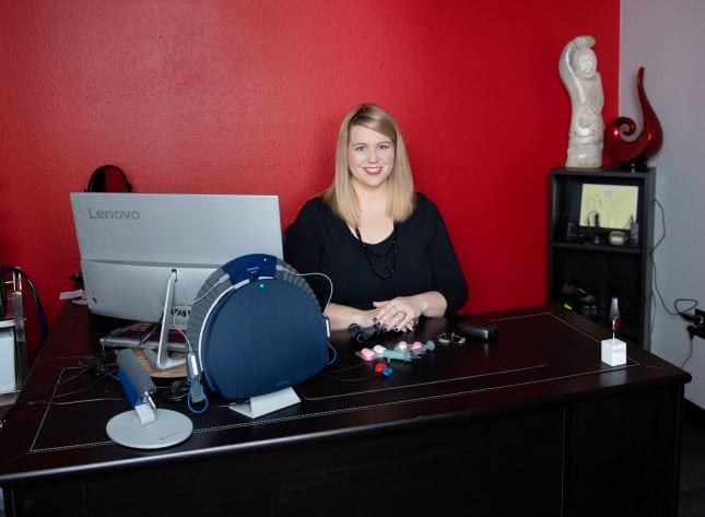 Dr Emily sitting at a desk